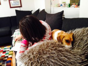 Pip reading with her dog.